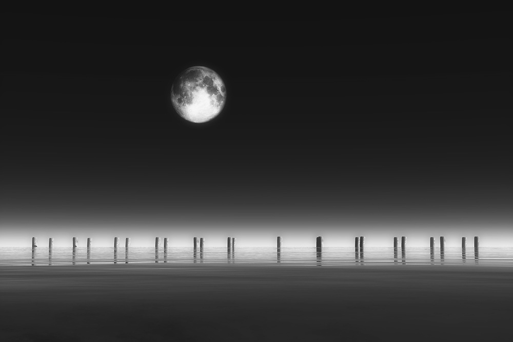 Over a lonesome pier, we are greeted with stark, brilliant images of the water and the moon. We can look to the moon, and we can stare at the water, and we can transport ourselves to another place entirely. That is one of the most appealing aspects of this fine art piece by Jan Keteleer. You can simply stare at the piece and imagine something else entirely. You are going to need to remember that this is a time and place that may not exist in the real world. Where do you think it is? Where does this scene take you? .<br /> <br /> BUY THIS PRINT AT<br /> <br /> FINE ART AMERICA<br /> ENGLISH<br /> https://janke.pixels.com/featured/1-moonrise-jan-keteleer.html