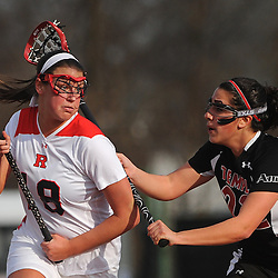 Rutgers sophomore attacker Megan Clements cradles the ball away form Temple senior defender Lauren Caminiti. Temple defeated Rutgers 12-11 in NCAA women's college lacrosse at the Rutgers Turf Field in Piscataway, N.J.
