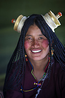 """A Tibetan nomad woman all dressed up during an annual horse racing festival in the vicinity of Lithang, Sichuan Province, China<br /> Available as Fine Art Print in the following sizes:<br /> 08""""x12""""US$   100.00<br /> 10""""x15""""US$ 150.00<br /> 12""""x18""""US$ 200.00<br /> 16""""x24""""US$ 300.00<br /> 20""""x30""""US$ 500.00"""