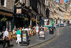 View of bars on historic Cockburn Street in Old Town of Edinburgh, Scotland, UK