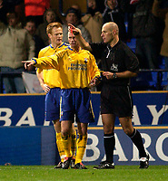 Photo. Jed Wee.<br /> Bolton Wanderers v Southampton, FA Barclaycard Premiership, Reebok Stadium, Bolton. 08/11/03.<br /> Southampton's Michael Svensson (L) is given his marching orders by referee H Webb (R) after he is shown a second yellow card, as Chris Marsden tries to plead in his defence.