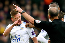 Leicester City's Marc Albrighton (left) reacts after receiving a red card from Referee Mike Dean during the Premier League match at Selhurst Park, London.