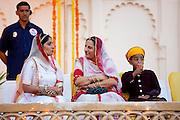 Feudal family of Karjali at Maharana Holi festival at the City Palace, Udaipur Rajasthan, India L to R Sidhi Kumari, Karuna Kunwar, Bahv Vaibhav Singh