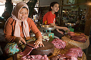 26 JUNE 2006 - SIEM REAP, CAMBODIA: A Cham woman cuts meat in the main market in Siem Reap, Cambodia, site of the world famous Angkor Wat. The Cham are an ethnic minority in Cambodia who are predominantly Muslim. Photo by Jack Kurtz / ZUMA Press