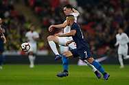 Michael Keane of England under pressure from Bobby Wood of USA during the International Friendly match between England and USA at Wembley Stadium, London, England on 15 November 2018.