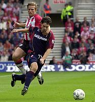 Photo: Greig Cowie, Digitalsport<br /> 27/09/2003.<br /> FA Barclaycard Premiership. Southampton v Middlesbrough, The St Marys Stadium.<br /> Anders Svensson hauls down goal hero Malcolm Christie