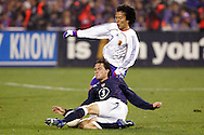10 February 2006: Todd Dunivant (3), of the United States, tackles the ball away from Japan's Makoto Hasebe (17). The United States Men's National Team defeated Japan 3-2 at SBC Park in San Francisco, California in an International Friendly soccer match.