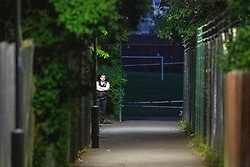 © Licensed to London News Pictures. 31/05/2021. London, UK. A police officer guards the crime scene at Montrose Park, Edgware following the fatal stabbing of an 18-year-old male. Metropolitan Police were called at 17:54 BST on Monday 31/05/2021 following reports of a group of males fighting. The man was found suffering from a stab injury in a tennis court area. He was treated by London's Air Ambulance and London Ambulance Service at the scene but was pronounced dead at 19:19 BST. Photo credit: Peter Manning/LNP