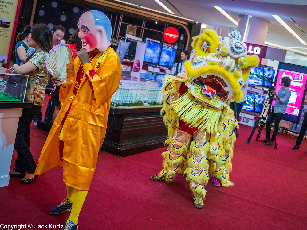 07 FEBRUARY 2013 - BANGKOK, THAILAND:   Chinese Lion Dancers perform in the Siam Paragon Mall in Bangkok. The weeks surrounding Chinese New Year are important for retailers in Thailand and many malls put on special promotions and events honoring Chinese culture, like Lion Dances or Chinese Opera. Thailand has a large Thai-Chinese population. Millions of Chinese emigrated to Thailand (then Siam) in the 18th and 19th centuries and brought their cultural practices with them.   PHOTO BY JACK KURTZ