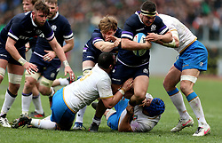 Scotland's Stuart McInally (second right) in action during the NatWest 6 Nations match at the Stadio Olimpico, Rome.