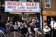 The famous Bagel Bake bakery on Brick lane on Sunday Market day. This is the most famous baget shop in London. This market is a weekly event in London's East End.