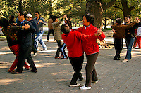 Dancing in Beihai Park which is an imperial garden to the northwest of the Forbidden City in Beijing. Originally built in the 10th century, it is among the largest of Chinese gardens and contains numerous historically important structures, palaces and temples.