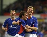 Fotball: Dunfermline v Rangers, Scottish Premier League, East EDnd Park, Dunfermline. Pic Ian Stewart, Saturday 11th. August 2001<br />Fernando Ricksen and flo celebrate after flo's goal