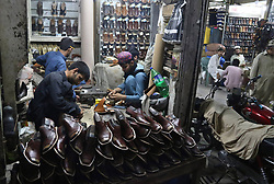 June 19, 2017 - Pakistan - PESHAWAR, PAKISTAN, JUN 19: Workers making traditional footwear Peshawari Chappal at .Jehangirpura on demand ahead of Eid-ul-Fitar on Monday, 19 June 2017. (Credit Image: © PPI via ZUMA Wire)