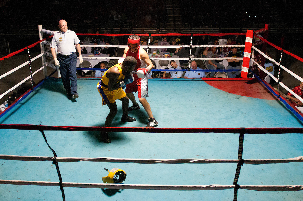 Matt Dixon   The Flint Journal..Jonathan Scroggins of Flint Berston Boxing Club looses his helmet while fighting Mike Ramos during a Golden Gloves Boxing regional tournament at the Birch Run Expo Center, Friday, April 1.