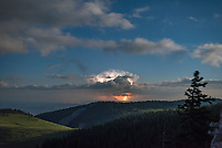 One of my goals this summer was to capture a lightning storm from the Bighorn Mountains. But it's not easy since by the time a storm pops up it may be too late to get to the right spot. And once I'm in the mountains, lack of cell data makes it hard to know what's happening with the weather. But storms weren't even expected on this night. I was camping near an overlook called Freeze Out Point. At 11PM I went up to the overlook one last time and was surprised to see flashes to the east. The cell was some 75 miles away in Montana, and at that distance lightning often appears red as it's seen through the thicker lower atmosphere. Distant lightning strikes that are silent and without thunder are often called heat lightning. But heat lightning isn't really a specific type, thunder simply can't be heard from more than 10 miles away. There was just enough time to shoot a time lapse of this moonlit lightning storm before low clouds and fog came in and obscured the view.