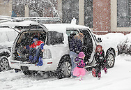 Middletown, New York  - Children in costumes climb out of a car during a snowstorm on the way to the Middletown YMCA Family Fall Festival on Oct. 29, 2011.