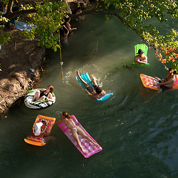 Weary Austin, Texas residents and visitors eager to get outdoors during the coronavirus pandemic ignore social distancing guidelines to have fun in the cool waters of Barton Creek south of downtown.<br /> Temperatures hit triple digits and a continued Texas heat wave is expected into September.