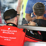 Austin Dillon, driver of the (3) Dow Chevrolet, is seen signing autographs in the garage area during practice for the 60th Annual NASCAR Daytona 500 auto race at Daytona International Speedway on Friday, February 16, 2018 in Daytona Beach, Florida.  (Alex Menendez via AP)