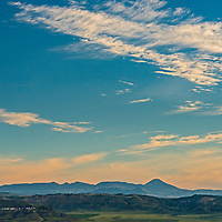 The Bears Paw Mountains rise behind Missouri River Breaks in north central Montana.