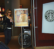 """**EXCLUSIVE**.Carmen Electra buys a frapuccino at Starbucks located at the American Airlines Terminal at LAX Airport before boarding a plane to JFK. She is in New York to do some press for her new movie """"Epic Movie"""". She wanted to make sure she was OK with PETA so she told our photographer. """"The fur in my jacket is faux, touch it."""".LAX and JFK Airport.Los Angeles, CA, USA .Saturday, January 20, 2007.Photo By Celebrityvibe.com.To license this image call (212) 410 5354 or;.Email: celebrityvibe@gmail.com; .Website: http://www.celebrityvibe.com/."""