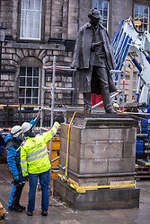 The sculpture of Sherlock Holmes by former pop-artist Gerald Laing is being moved from it's home on Picardy Place, yards from the birth place of Sir Arthur Conan Doyle.<br /> <br /> The move of the sculpture is to accommodate road and tram works that are taking place in Edinburgh. The statue will be moved to Nairn at  Black Isle Bronze Ltd by the artists son, Farquhar Laing where it will stay for two years until it returns to Edinburgh.<br /> <br /> Pictured: Workers prepare to move the Sherlock Holmes statue