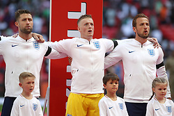 England's (from left to right) Gary Cahill, Jordan Pickford and Harry Kane sing the national anthem before the International Friendly match at Wembley Stadium, London.