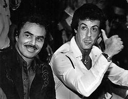 July 31, 1982 - Florida, U.S. - 7/31/82 - Burt Reynolds and Sylvester Stallone ham it up for fans as they sit at ringside last Saturday night waiting for the main event to begin. (Credit Image: © Handout/The Palm Beach Post via ZUMA Wire)