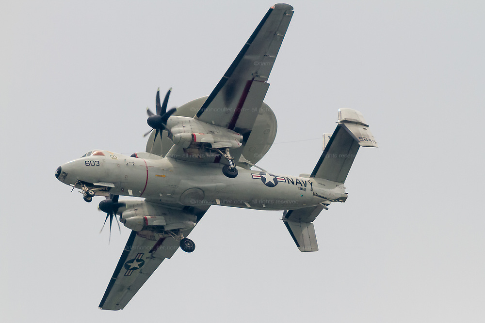 """A Northrop Grumman E2 Hawkeye, early warning aircraft with Carrier Airborne Early Warning Squadron 115 (VAW-115), also known as the """"Liberty Bells"""" flies over  Kanagawa, Japan. Tuesday May 31st 2016."""