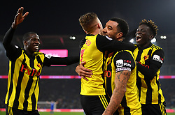 Watford's Troy Deeney (centre right) celebrates scoring his side's fourth goal of the game with team-mates during the Premier League match at the Cardiff City Stadium.