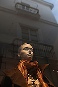 Traditional architecture reflected on a fashion store window in Cadiz, Andalucía, Spain.