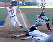 Virginia's (Joe McCarthy (31) slides safely into home plate in the 3rd inning of the first game against Maryland at Davenport Field. Virginia defeated Maryland 7-6. Photo/The Daily Progress/Andrew Shurtleff