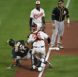 August 22, 2017 - Baltimore, MD, USA - Baltimore Orioles catcher Caleb Joseph, center, tags out the Oakland Athletics' Matt Chapman, left, during a rundown in the eighth inning at Oriole Park at Camden Yards in Baltimore on Tuesday, Aug. 22, 2017. The A's won, 6-4. (Credit Image: © Kenneth K. Lam/TNS via ZUMA Wire)