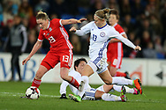 Rachel Rowe of Wales (13)  goes past the tackle from Karina Zhumabaikyzy (c) and   Svetlana Bortnikova ® of Kazakhstan .Wales Women v Kazakhstan Women, 2019 World Cup qualifier match at the Cardiff City Stadium in Cardiff , South Wales on Friday 24th November 2017.    pic by Andrew Orchard