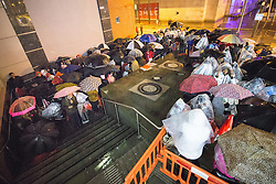 © Licensed to London News Pictures . 26/12/2015 . Manchester , UK . Bargain hunters queue overnight in the rain outside Next at Manchester's Arndale Centre , for the 6am start of the annual winter sale . Photo credit: Joel Goodman/LNP