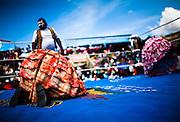 Abril y Mayo 2011/Bolivia<br /> <br /> Julia La Paceña de vestido naranjo en suelo es derrotada por Carmen Rosa y su compañero el enmascarado<br /> <br /> Foto.Juan Gonzalez
