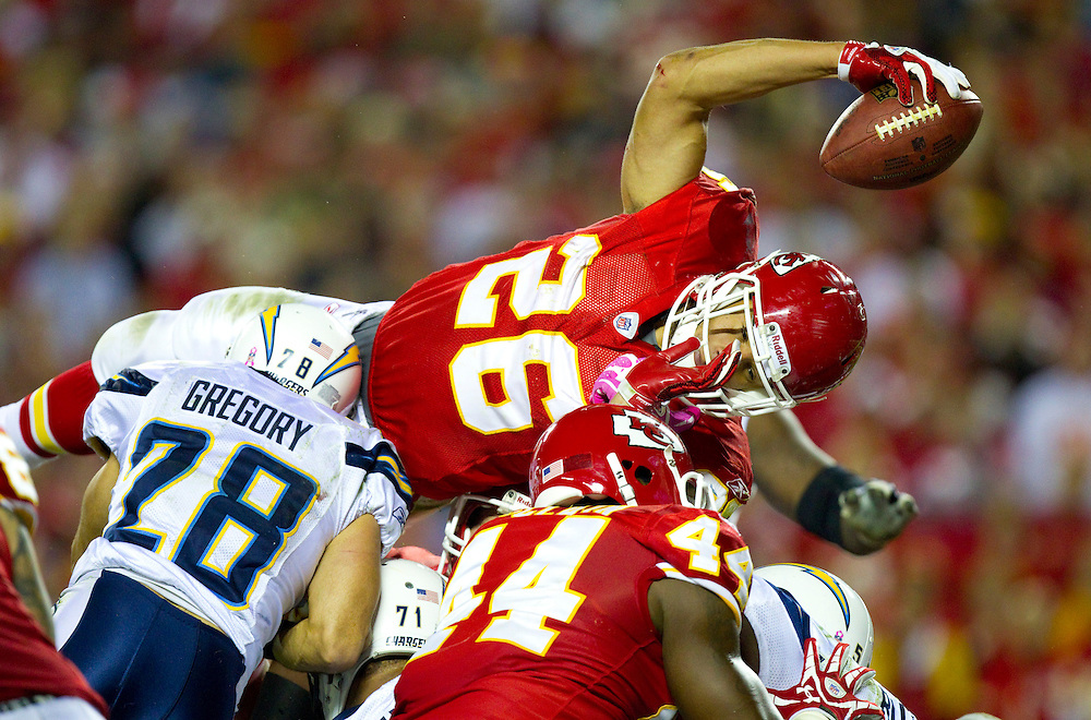Kansas City Chiefs running back Jackie Battle leaped over the pile of San Diego Chargers defensive players as he scored a fourth quarter touchdown during the Chiefs' 23-20 overtime victory on Monday Night Football on October 31, 2011, in Kansas City, MO.