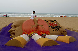 May 30, 2017 - Bhubaneswar, India - A sand sculpture is seen at the Bay of Bengal Sea's eastern coast beach at Puri to spread awareness on the occasion of World No Tobacco Day, 60 km away from the eastern Indian state Odisha's capital city Bhubaneswar, on May 31, 2017. (Credit Image: © Str/NurPhoto via ZUMA Press)