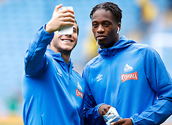 Huddersfield Town's Ramadan Sobhi (left) and Terence Kongolo take a selfie before the Premier League match at the Etihad Stadium, Manchester.