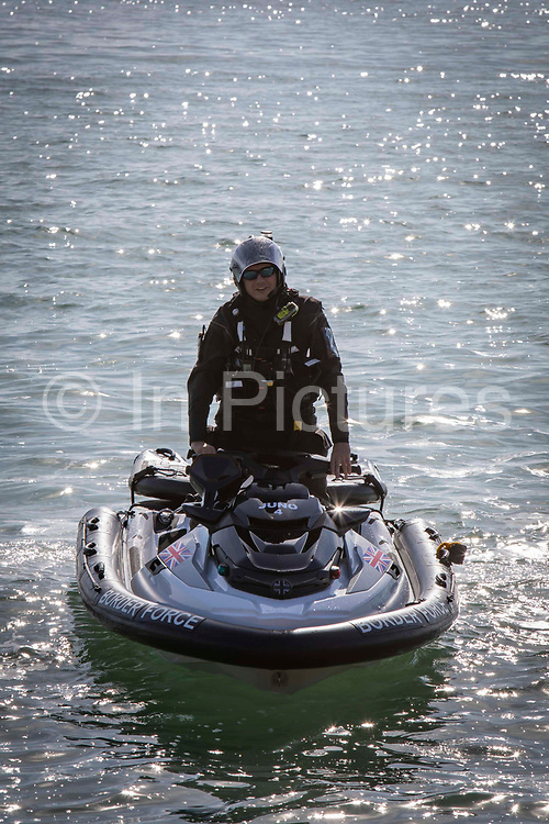 Border Force officers patrol the Kent coastline using personal water crafts on the 8th of October 2021 in Folkestone, United Kingdom. The Home Office has begun using Jet Ski's or personal water crafts to move along the coast quicker and intercept small boats used by asylum seekers to cross the channel from France.
