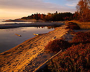 Sunset light illuminating the mouth of the Sand River along the shore of Lake Superior, Lake Superior Provincial Park, Ontario, Canada.