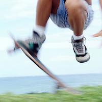 Beach Rat skateboader in motion of making jump