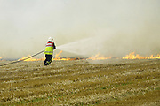 firefighters tackle a stubble blaze in fields near the village of Barton Seagrave, Northamptonshire.<br />