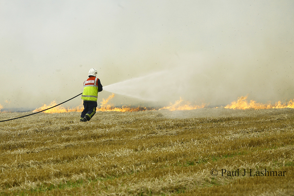 firefighters tackle a stubble blaze in fields near the village of Barton Seagrave, Northamptonshire.<br /> Summer 2008