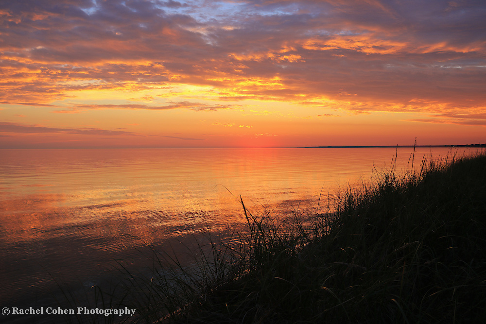 """""""Dream On""""<br /> <br /> An amazing sunset on the shores of Lake Michigan near St. Ignace! Beautiful colors of gold, orange and purple adorn the sky and reflections on the glassy lake!"""