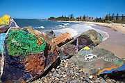 The main beach in Port Macquarie with graffiti on the rocks, NSW, Australia..Paul Lovelace Photography