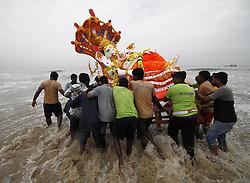 CHENNAI, Sept. 12, 2016 (Xinhua) -- Devotees push an idol of Hindu god Lord Ganesha into the sea in celebration of Ganesh Chaturthi festival in Chennai, Indian southeastern state of Tamil Nadu, Sept. 11, 2016. Ganesh Chaturthi is the Hindu festival celebrated in honor of the elephant-headed god Ganesha. (Xinhua/Stringer).****Authorized by ytfs* (Credit Image: © Stringer/Xinhua via ZUMA Wire)