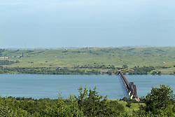 View of Missouri River at Chamberlain South Dakota may include any of the bridges: DSRC Railroad Bridge, the I-90 Chamberlain Bridge, Presho Railroad Bridge and the Chamberlain Pontoon Bridge.