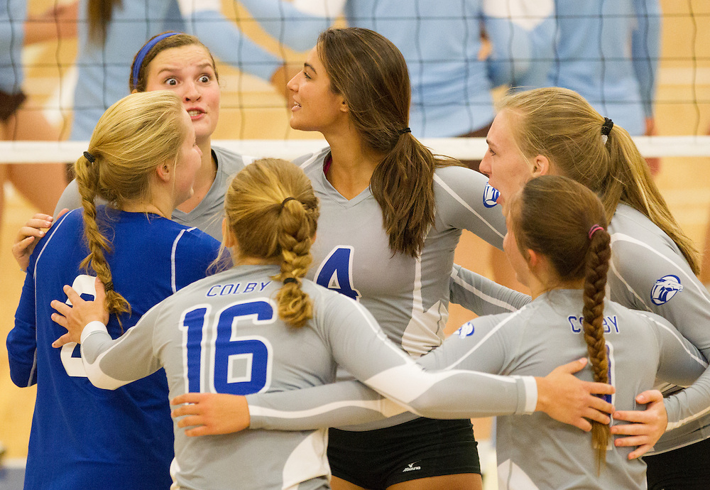 Karolina Serhan and Elizabeth Noyes, of Colby College, during an NCAA Division III volleyball match against Tufts University at The Whitmore-Mitchell at Wadsworth Gymnasium, Saturday Sep. 19, 2014 in Waterville, ME.  (Dustin Satloff/Colby College Athletics)