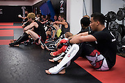 Fighters line the wall before class at Jackson Wink MMA in Albuquerque, New Mexico on June 9, 2016.